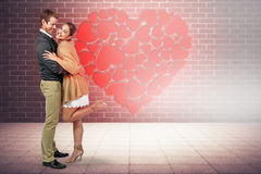 Composite image of full length of romantic couple hugging Royalty Free Stock Photos