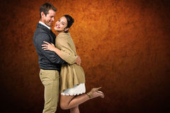 Composite image of full length of romantic couple hugging Royalty Free Stock Image