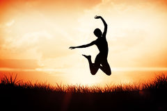 Composite image of full length of a sporty young woman jumping Stock Photography