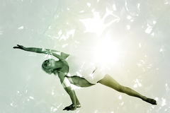 Composite image of full length of a sporty young woman practicing yoga Royalty Free Stock Image