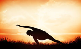 Composite image of full length of a sporty young woman practicing yoga Stock Photo