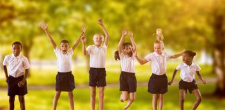 Composite image of full length of students in school uniforms jumping Stock Image