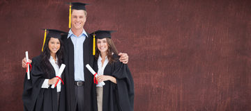 Composite image of full length of three friends graduate from college together Royalty Free Stock Photo