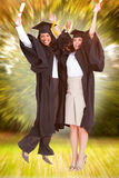 Composite image of full length of two women celebrating in the air Royalty Free Stock Photos