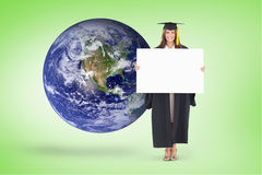 Composite image of full length of a woman holding a blank sheet in front of her as she smiles Royalty Free Stock Photo
