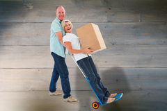 Composite image of fun older couple holding moving boxes Stock Photos