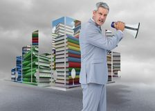 Composite image of furious businessman posing with loudspeaker Royalty Free Stock Photos