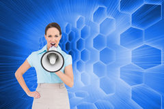 Composite image of furious businesswoman talking in megaphone Royalty Free Stock Photo