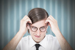 Composite image of furious geeky businessman Stock Photo