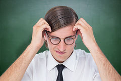 Composite image of furious geeky businessman Stock Photography