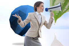 Composite image of furious stylish brown haired businesswoman shouting in a megaphone Stock Photography