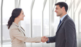 Composite image of future partners shaking hands Stock Images