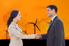 Composite image of future partners shaking hands Stock Photography