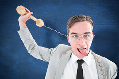 Composite image of geeky businessman being strangled by phone cord Stock Photos