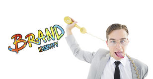Composite image of geeky businessman being strangled by phone cord Royalty Free Stock Photos