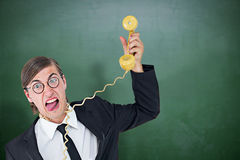 Composite image of geeky businessman being strangled by phone cord Stock Image