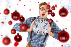 Composite image of geeky businessman holding a clock Royalty Free Stock Photos