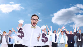 Composite image of geeky businessman holding money bags Stock Images