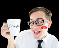 Composite image of geeky businessman holding a mug Royalty Free Stock Photos