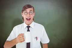Composite image of geeky businessman holding a mug Stock Images