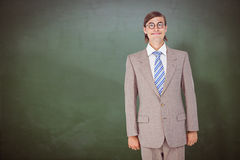 Composite image of geeky businessman looking at camera Royalty Free Stock Photo