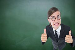 Composite image of geeky businessman looking at camera thumbs up Royalty Free Stock Photography