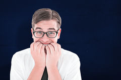Composite image of geeky businessman looking nervously at camera Stock Photography