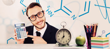 Composite image of geeky businessman pointing to calculator Royalty Free Stock Photo