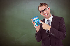 Composite image of geeky businessman pointing to calculator Stock Photo