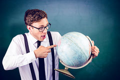 Composite image of geeky businessman pointing to globe Royalty Free Stock Photos
