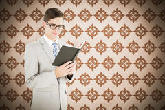 Composite image of geeky businessman reading black book Royalty Free Stock Photos