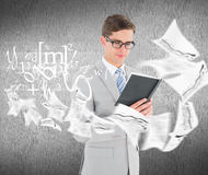 Composite image of geeky businessman reading black book Stock Photos