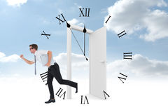 Composite image of geeky businessman running late Royalty Free Stock Image