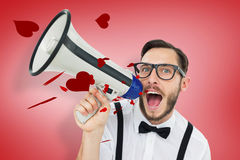 Composite image of geeky businessman shouting through megaphone. Geeky businessman shouting through megaphone against red vignette Stock Photos
