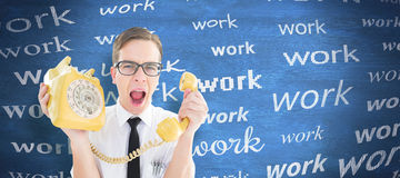 Composite image of geeky businessman shouting at retro phone. Geeky businessman shouting at retro phone against blue chalkboard Royalty Free Stock Photo