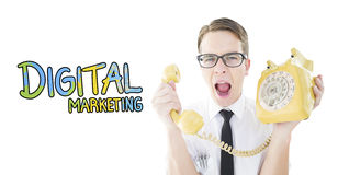Composite image of geeky businessman shouting at retro phone. Geeky businessman shouting at retro phone against digital marketing Stock Photo