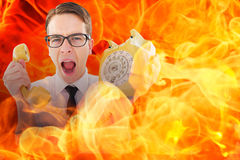 Composite image of geeky businessman shouting at retro phone Stock Photos