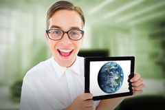 Composite image of geeky businessman showing his tablet pc Stock Image