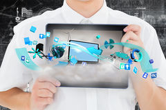 Composite image of geeky businessman showing his tablet pc Royalty Free Stock Photos