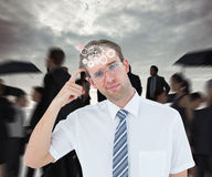 Composite image of geeky businessman thinking with finger on temple Stock Images
