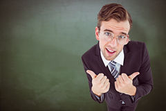 Composite image of geeky businessman with thumbs up Royalty Free Stock Photography