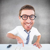 Composite image of geeky businessman typing Royalty Free Stock Images