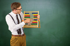 Composite image of geeky businessman using an abacus Stock Images