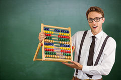 Composite image of geeky businessman using an abacus Stock Image