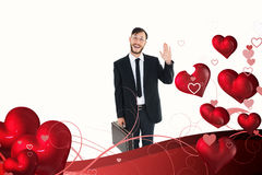 Composite image of geeky businessman waving at camera Royalty Free Stock Photos