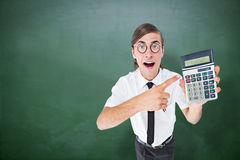Composite image of geeky cheering businessman holding calculator Stock Image
