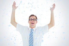 Composite image of geeky happy businessman with arms up Royalty Free Stock Photography