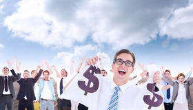 Composite image of geeky happy businessman holding bags of money Stock Image