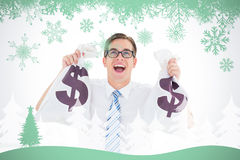 Composite image of geeky happy businessman holding bags of money Royalty Free Stock Photos