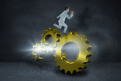 Composite image of geeky happy businessman running mid air Royalty Free Stock Photos